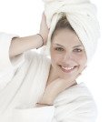 Beautiful woman with a white towel on her head isolated on white background